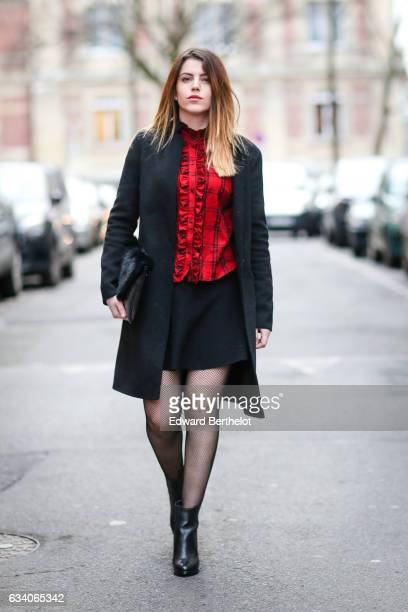 Sara Carnicella fashion blogger from La Fille Rebelle wears a Zara red top a Zara black coat a Nicoletta Parodi black clutch with fur a Zara black...