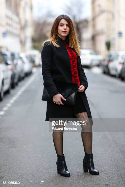Sara Carnicella fashion blogger from La Fille Rebelle wears a Zara red top a Zara black coat a Nicoletta Parodi black clutch with fur a Zara black...
