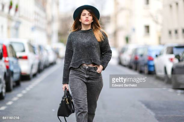 Sara Carnicella fashion blogger from La Fille Rebelle wears Texto black shoes a Zara gray wool pull over Calzedonia fishnet tights Zara gray denim...