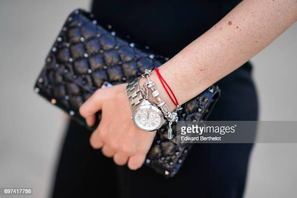 Sara Carnicella fashion blogger La Fille Rebelle wears a black off shoulder lace top black pants a Valentino Rockstud bag a watch and Valentino heels...