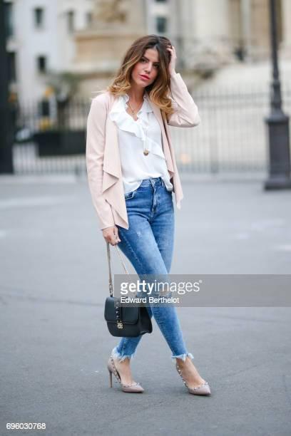 Sara Carnicella, fashion blogger, wears a Delphine Pariente necklace, A valentino bag, Valentino rockstud heels shoes, Bershka blue denim ripped...