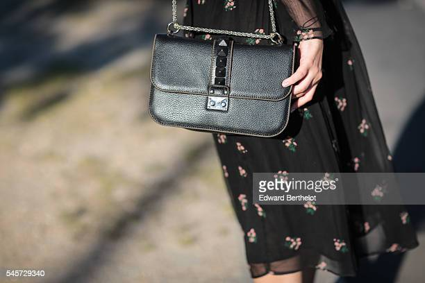 Sara Carnicella is wearing a Zara black dress a Glam Lock Valentino black bag and Pierre Hardy heels shoes during a street style session near the Arc...