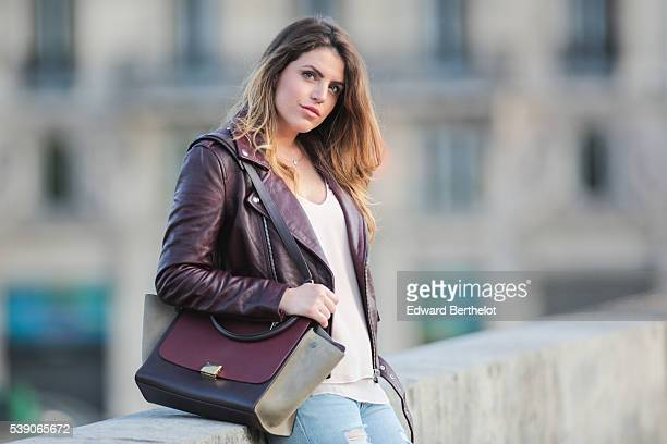 Sara Carnicella is wearing Givenchy shoes a Zara top Zara jeans a Celine Trapezio bag and an Iro leather jacket during a street style session on June...