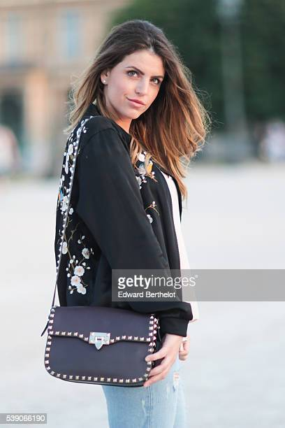 Sara Carnicella is wearing Givenchy shoes Zara jeans a Zara jacket and a Valentino bag during a street style session on June 09 2016 in Paris