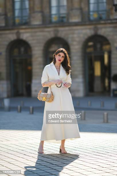 Sara Carnicella @lafillerebelle wears white vintage sunglasses, gold and silver earrings, gold chain necklaces, a white V-neck Natan belted long...