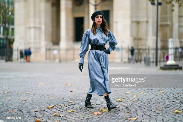 Sara Carnicella wears a blue Victoria Tomas dress with puff sleeves, black leather gloves from Celine, black high heel shiny leather Vuitton pointy...
