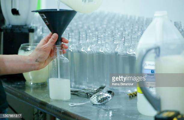 Sara Cartelli fill it up bottles with a Hand Sanitizer mix At the Claremont Distillery on March 20 2020 in Fairfield New Jersey With the shortage of...