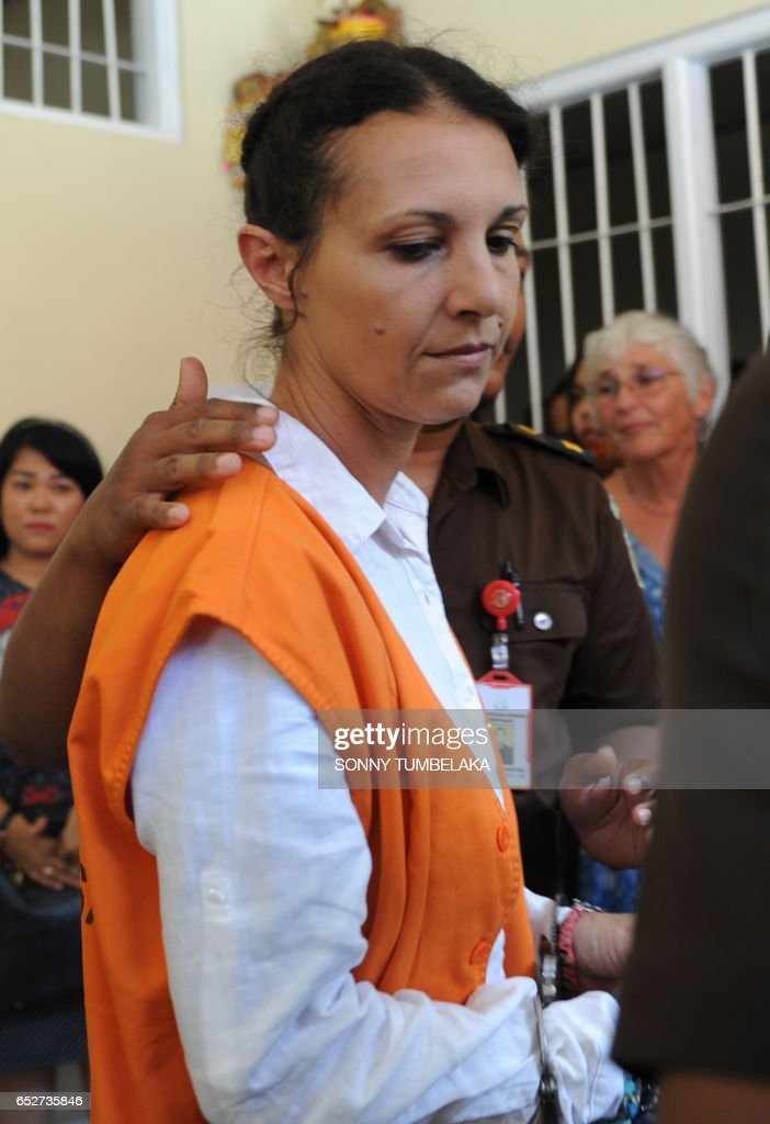 Sara Connor of Australia walks to the court for her trial in Denpasar on Indonesia's resort island of Bali on March 13, 2017. David Taylor was found guilty at a court on the island of fatal group assault over the killing of officer Wayan Sudarsa, whose battered body was found in August last year. The court was due to hand down its verdict for his Australian girlfriend Sara Connor, 46, on March 13. TUMBELAKA