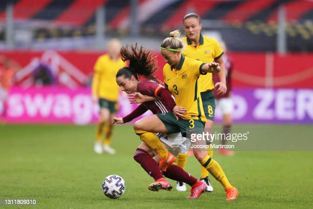 Sara Dabritz of Germany and Aivi Luik of Australia battle for the ball during the Women's International Friendly match between Germany and Australia...