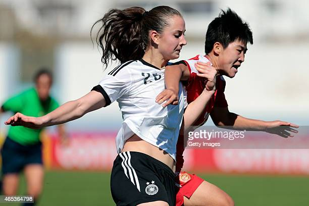 Sara Dabritz of Germany and Ren Guilin of China fighting for the ball during the Women's Algarve Cup match between Germany and China on March 6 2015...