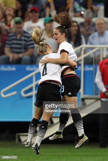 Sara Dabritz of Germany celebrates with Leonie Maier after scoring a goal during the first half against Australia in the Women's First Round Group F...