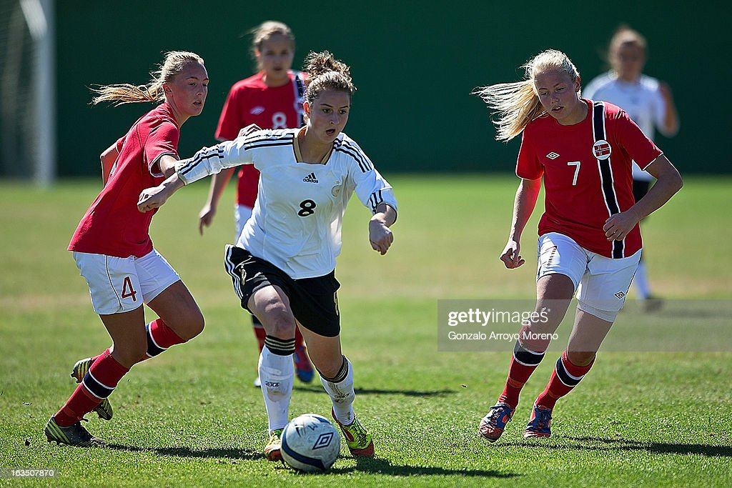 Sara Dabritz #8 of Germany in action against Carlotta Fennefoss (L) and Guro Bergsvand of Norway during the Women's U19 Tournament match between U19 Norway and U19 Germany at La Manga Club ground G on March 11, 2013 in La Manga, Spain.