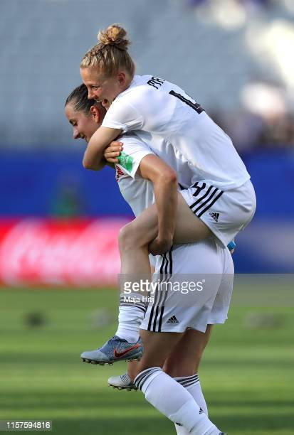 Sara Daebritz and Leonie Maier of Germany celebrate following their sides victory in the 2019 FIFA Women's World Cup France Round Of 16 match between...
