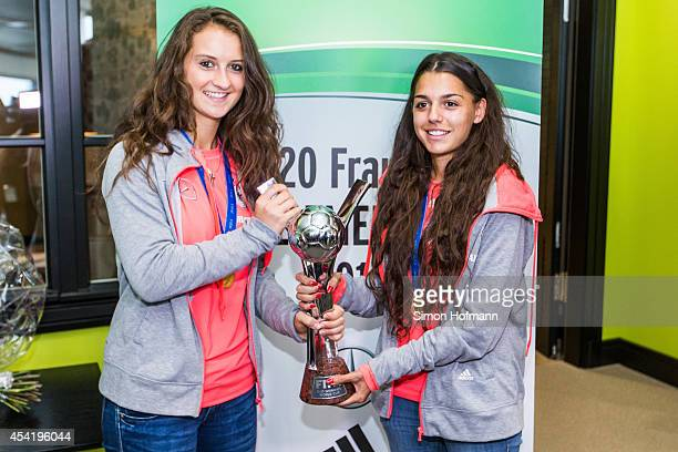 Sara Daebritz and Manjou Wilde pose during the Germany U20 Women's Welcome Home Reception As World Champions at Frankfurt International Airport on...