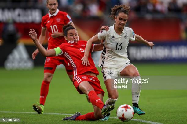 Sara Daebritz of Germany and Anna Kozhnikova of Russia battle for the ball during the Group B match between Russia and Germany during the UEFA...