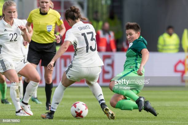 Sara Daebritz of Germany and Manja Rogan of Slovenia battle for the ball during the 2019 FIFA women's World Championship qualifier match between...