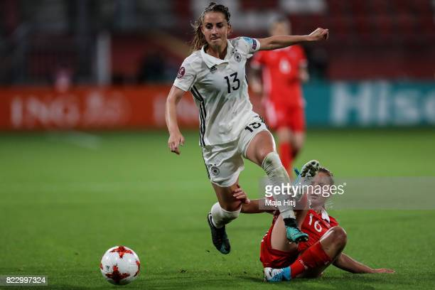Sara Daebritz of Germany and Marina Fedorova of Russia battle for the ball during the Group B match between Russia and Germany during the UEFA...