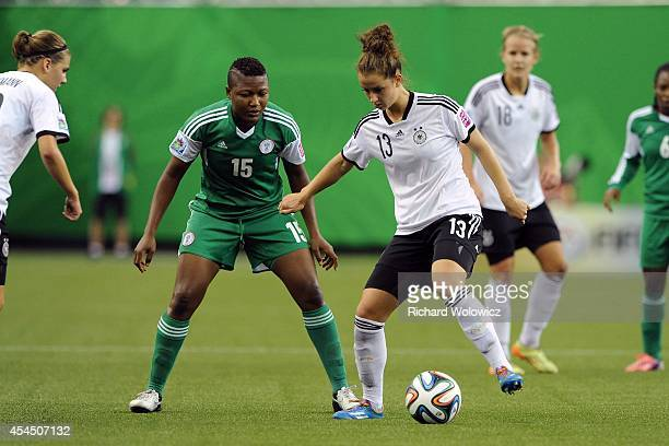 Sara Daebritz of Germany attempts to move the ball past Ugo Njoku of Nigeria during the FIFA Women's U20 Final at Olympic Stadium on August 24 2014...