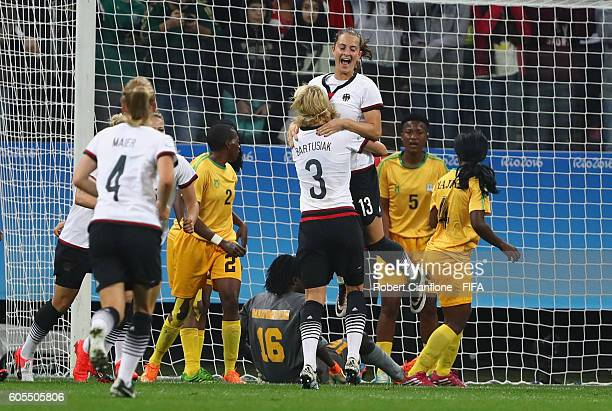 Sara Daebritz of Germany celebrates after scoring a goal during the Women's First Round Group F match between Zimbabwe and Germany at Arena...