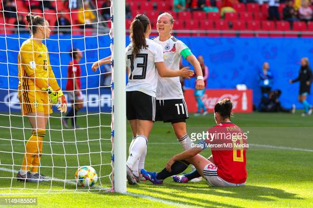 Sara Daebritz of Germany celebrates scoring the opening goal with teammate Alexandra Popp during the 2019 FIFA Women's World Cup France group B match...
