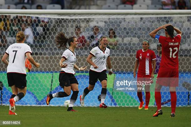 Sara Daebritz of Germany celebrates with her team mates after scoring her team's second goal during the Women's Semi Final match between Canada and...