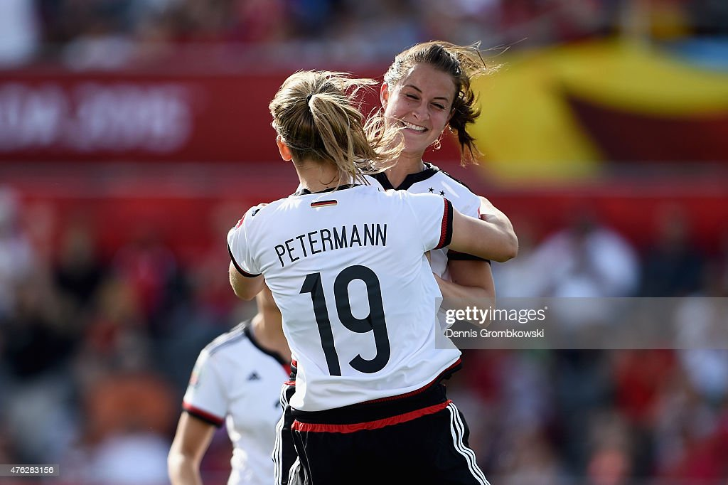 Sara Daebritz of Germany celebrates with team mate Lena Petermann as she scores the eighth goal during the FIFA Women's World Cup Canada 2015 Group B match between Germany and Cote D'Ivoire at Lansdowne Stadium on June 7, 2015 in Ottawa, Canada.