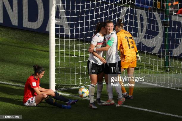 Sara Daebritz of Germany celebrates with teammates after scoring her team's first goal during the 2019 FIFA Women's World Cup France group B match...