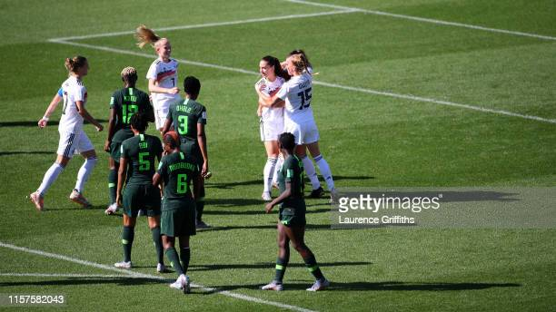 Sara Daebritz of Germany celebrates with teammates after scoring her team's second goal during the 2019 FIFA Women's World Cup France Round Of 16...