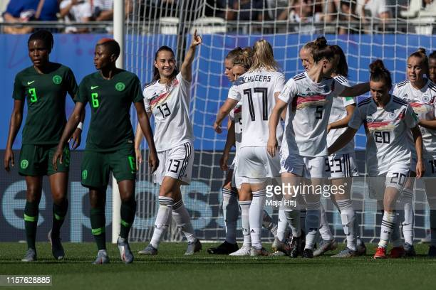 Sara Daebritz of Germany celebrates with teammates after scoring her team's second goal from the penalty spot during the 2019 FIFA Women's World Cup...