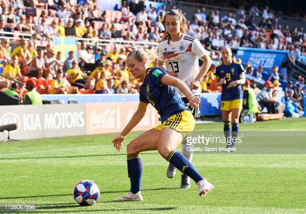 Sara Daebritz of Germany competes for the ball with Magdalena Eriksson of Sweden during the 2019 FIFA Women's World Cup France Quarter Final match...