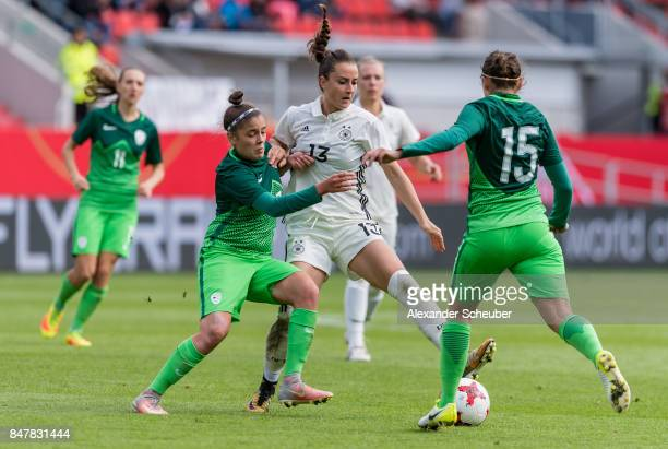 Sara Daebritz of Germany in action against Barbara Kralj of Slovenia during the 2019 FIFA women's World Championship qualifier match between Germany...
