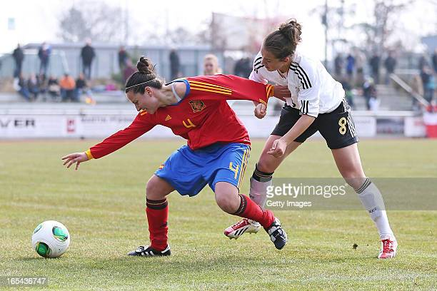 Sara Daebritz of Germany is challenged by Ivana Andres Sanz of Spain during the Women's UEFA U19 Euro Qualification match between U19 Germany and U19...