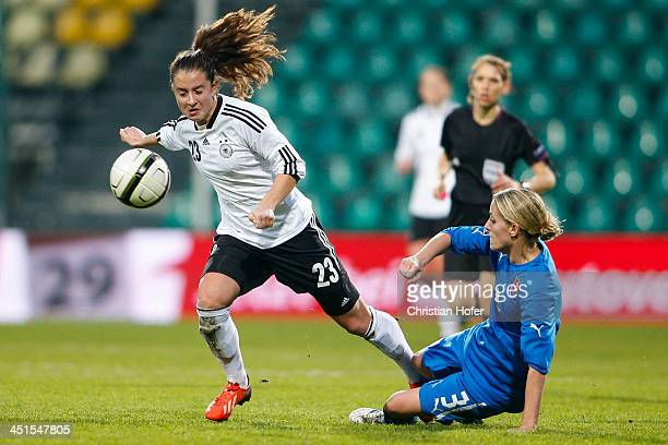 Sara Daebritz of Germany is tackled by Lenka Mravikova of Slovakia during the FIFA Women's World Cup 2015 Qualifier between Slovakia and Germany at...
