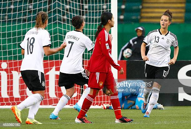 Sara Daebritz of Germany reacts after scoring a penalty kick against goalkeeper Lu Feifei of China PR at Commonwealth Stadium on August 8 2014 in...