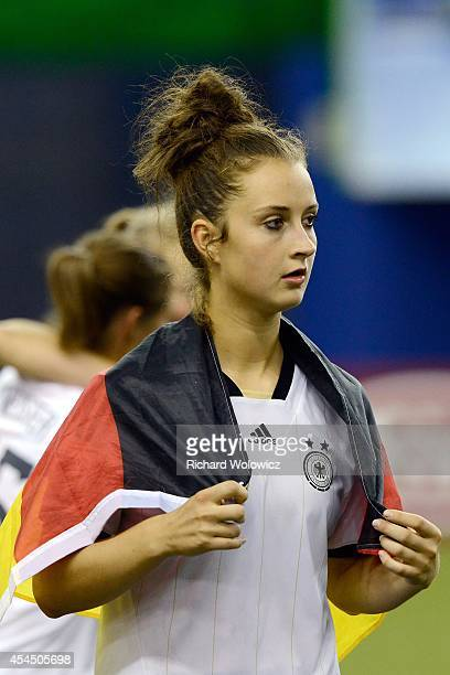 Sara Daebritz of Germany with the German flag during the FIFA Women's U20 Final against the Nigeria at Olympic Stadium on August 24 2014 in Montreal...