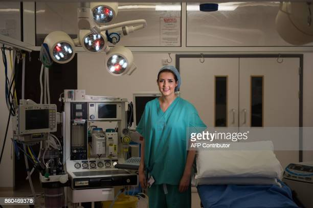 Sara Dalby a surgical care practitioner poses for a photograph in an operating theatre inside the Elective Care Centre building of Aintree University...