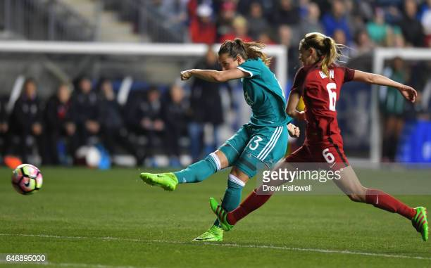 Sara Dbritz of Germany gets a shot off against a defending Morgan Brian of United States of America during the SheBelieves Cup at Talen Energy...