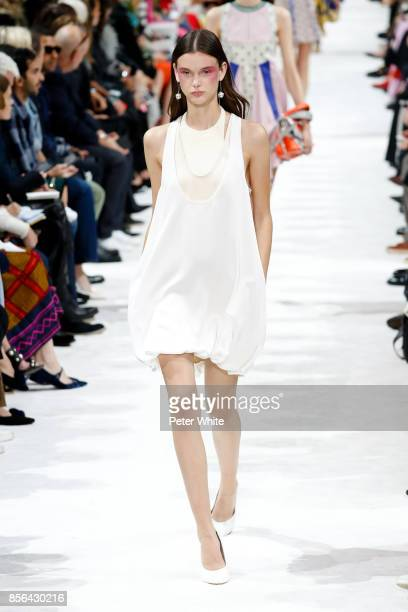 Sara Dijkink walks the runway during the Valentino show as part of the Paris Fashion Week Womenswear Spring/Summer 2018 on October 1 2017 in Paris...