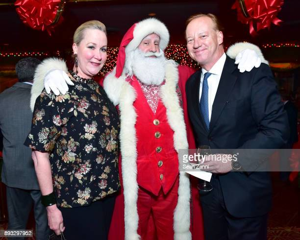 Sara Dodd Santa Claus and Will Denton attend A Christmas Cheer Holiday Party 2017 Hosted by George Farias and Anne and Jay McInerney at The Doubles...