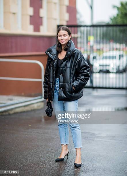Sara Donaldson wearing black puffer jacket light blue cropped denim jeans pointed heels is seen outside Camilla and Marc during MercedesBenz Fashion...