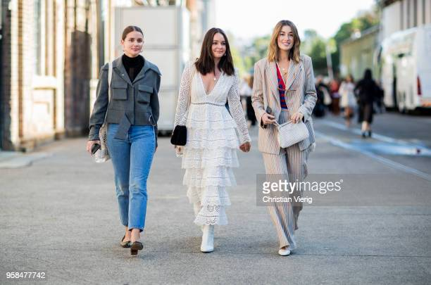 Sara Donaldson wearing grey jacket cropped denim jeans slingbacks a guest wearing white dress and Carmen Hamilton wearing striped suit red blue...