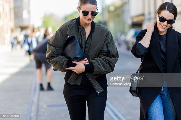 Sara Donaldson wearing Ray Ban sunglasses an olive Dion Lee bomber jacket and black Martin pants and clutch outside Georgia Alice at MercedesBenz...