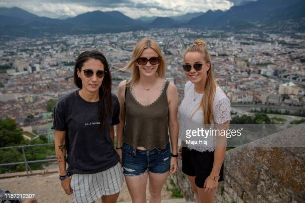 Sara Doorsoun Johanna Elsig and Giulia Gwinn of Germany pose for a picture as they visit the city Grenoble to the top of Bastilla on June 20 2019 in...