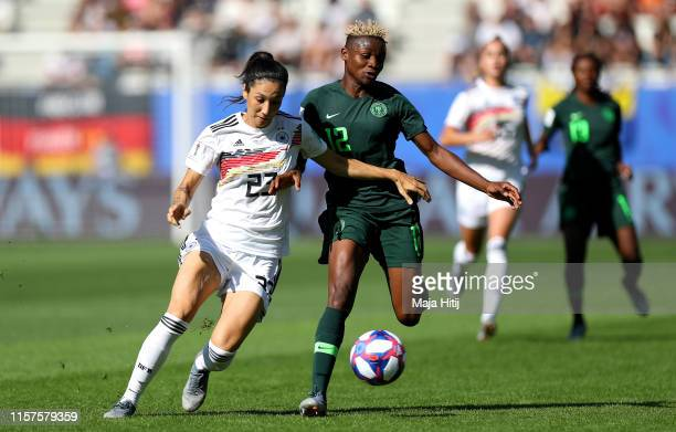 Sara Doorsoun of Germany is challenged by Uchenna Kanu of Nigeria during the 2019 FIFA Women's World Cup France Round Of 16 match between Germany and...