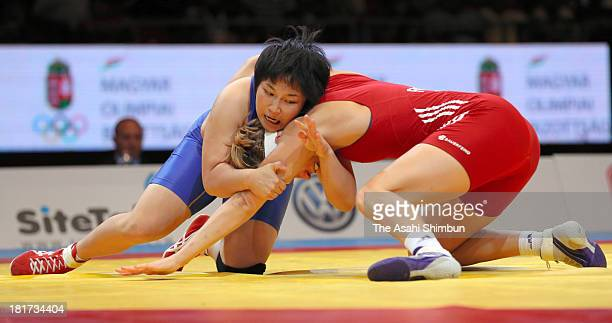 Sara Dosho of Japan and Aline Focken of Germany compete in the Women's 67kg Freestyle blonze medal match during day five of the FILA Wrestling World...