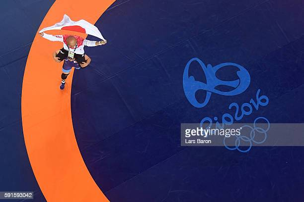 Sara Dosho of Japan celebrates after defeating Natalia Vorobeva of Russia in the Women's Freestyle 69 kg Gold Medal match on Day 12 of the Rio 2016...