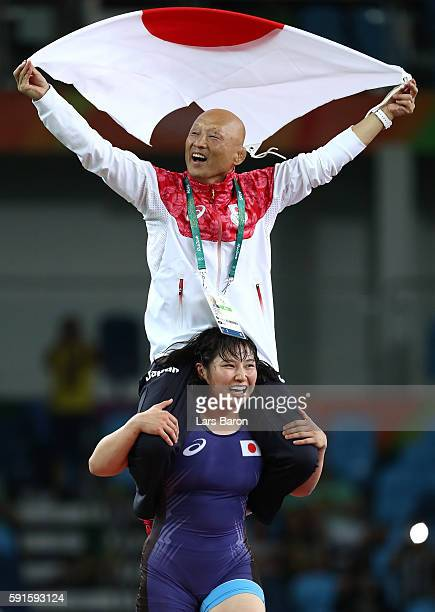 Sara Dosho of Japan celebrates with her coach after defeating Natalia Vorobeva of Russia in the Women's Freestyle 69 kg Gold Medal match on Day 12 of...