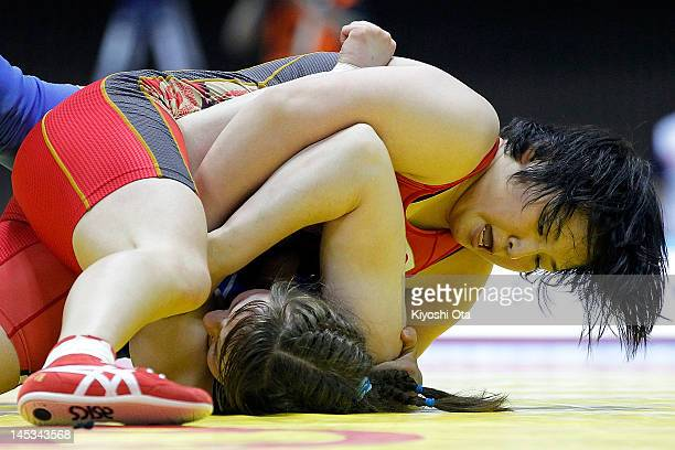 Sara Dosho of Japan competes against Yulia Prontsevich of Russia in the 67kg division of the final match between Japan and Russia during day two of...