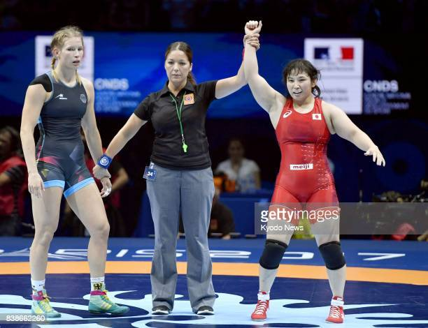 Sara Dosho of Japan is declared the winner after defeating Aline Focken of Germany in the women's 69kilogram final at the world wrestling...