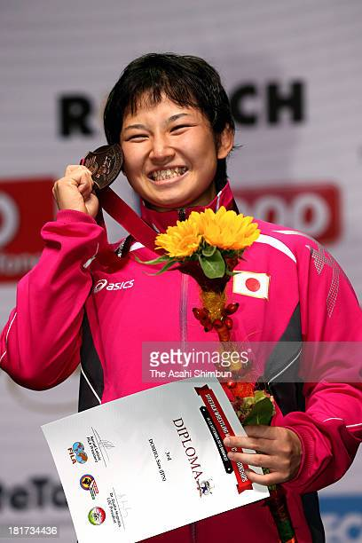 Sara Dosho of Japan poses for photographs after winning bronze medal in the Women's 67kg Freestyle during day five of the FILA Wrestling World...